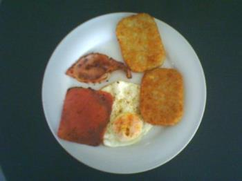 Breakfast - sunny side up egg, ham and hash brown breakfast