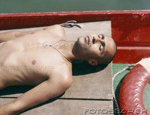 Sleeping naked - A guy sleeping naked.