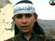 12 Year Old Killer - This a picture of the 12 year old boy seen in the video beheading an accused American spy.