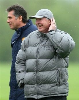 Alex & Carlos - Man Utd's manager Alex Ferguson and his right hand man, assistant manage Carlos Queiroz look on during a practice session