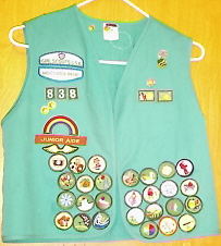 Girl Scout Vest - There are a lot of badges on the front. And there are also patches on the back. All of them are sewn on and some are also iron on.