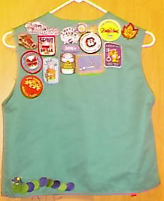 Back of Girl Scout Vest - Here are the patches on the back of her vest. This is only part of them. Only the best make it to the vest, others are put in a photo album.