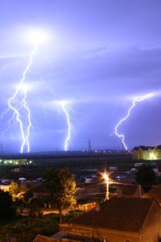 Lightning over Oradea, Romania - Lightning over the outskirts of Oradea, Romania, during the August 17, 2005 thunderstorm which went on to cause major flash floods over southern Romania. Text and image from http://en.wikipedia.org/wiki/Image:Lightning_over_Oradea_Romania_2.jpg . Image is public domain according to information presented on referenced page.