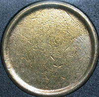 A planchet - A planchet is a prepared disc-shaped metal blank onto which the devices of a coin image are struck or pressed. The metal disc is called a blank until the time it passes through the upsetting machine which causes the rim to be raised. Once it has a rim, the disc is called a planchet.