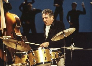 Gene Krupa, Great Jazz Drummer - picture of Gene Krupa sitting at his full set of drums. Considered by many to be one of the all time great jazz drummers in the world.