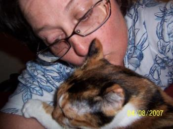 Me with my loving Abigail.  - Abigail is loving me and my glasses are falling off my nose as ususal. When I get involved with loving my pets I forget my glasses fall off my face.