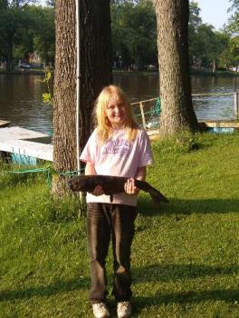 Caroline and her 6+ pound catfish - This is a pic of our daughter and the catfish she caught while camping Memorial weekend. 9yrs old and she fought this s*cker for a good 20min. in a boat to reel it in. Dad helped with the net once it got close enough.