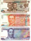 Philippine Peso - Philippine Peso Currencies in Ten Pesos (brown), Twenty Pesos (orange), One Hundred Pesos (purple).