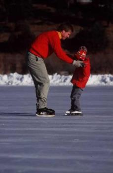 Father's Helping Hands - This photo shows a father helping his child during ice skating...a father who cares is always willing to lend a hand...