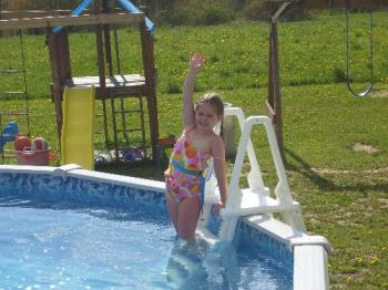 My daughter going swimming - Katelyn getting in the pool.
