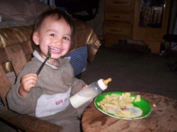 My son with his table and chair. - Dorian loves to eat at his mini table!