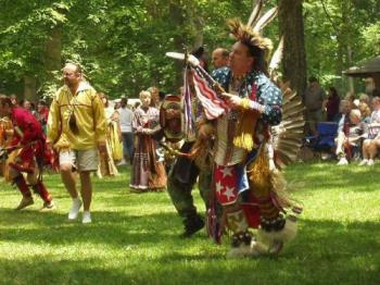 Native American Indian dancers - These dancers are wearing primarily woodland or plains Indian regalia.