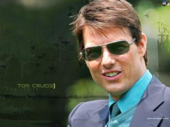 Tom Cruise - Tom Cruise looking very handsome in a grey coat with blue shirt.He is also wearing googles which is making him look even more better.