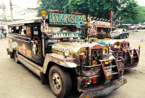 Philippine Jeepneys - Jeepneys are the most common form of public transport throughout the many islands of the Philippines. In Manila they are so numerous, that there is almost constantly traffic congestion. The jeepneys don't have air-conditioning. They have open windows. Most of the time the jeepneys are constantly-packed with many passengers. Jeepneys offer one of the cheapest ways of getting somewhere.
