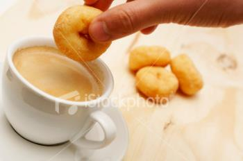 dunking mini donuts -  we dunk donuts in coffee
