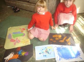 this is jenni with her sister and the art - lol Jenni, my youngest daughter was very proud of her art portfolio and wanted me to put it on display