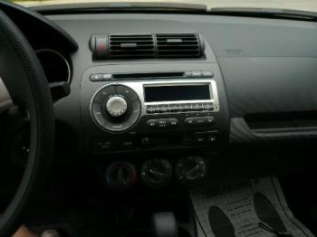 Honda Fit - The stereo system in my new car. It has a nice radio and cd system with cool features and great sound.