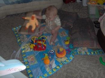 KJ and his favorite monkey - This is my son playing on the floor of the living room
