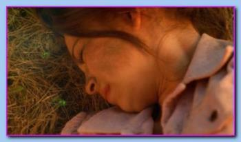 "Kristin Kreuk - Kristin Kreuk as Lana Lang in Smallville ""Sbscura"" after the explosion and unconscious among meteor rock fragments."