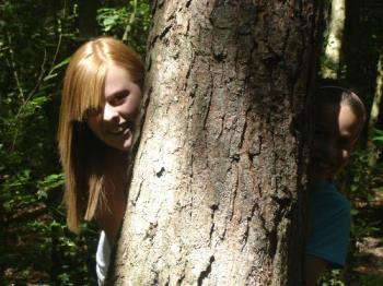 Sarah and Lauren Behind a Tree - Hiding behind a tree in St. Leonards Forest