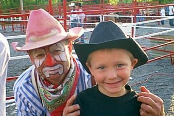 My Son and the Rodeo Clown - This is a picture of my son at the rodeo that comes to town every year. He had a great time, and the clown seemed to pick him out for alot of activities that they do with the young children.