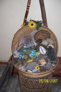 Collection of rocks and shells - This is just one of the many baskets of polished rocks, crystals and shells I have collected. Each one has special meaning to me and this large collection in a wicker stand sits by the deck doors that lead to our garden.