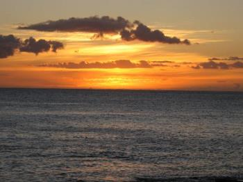Sunset in Hawaii - This was taken with a Canon Powershot A530 without a tripod. I used the Auto Mode and focused just below the sun to make the under expose the photo and bring out the color more.