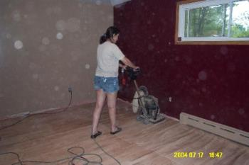Refinishing the floor - Here you can see the machine she rented to do the floor.