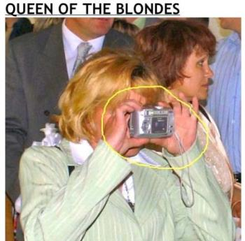 Blonde taking a picture - Notice the positioning of the camera