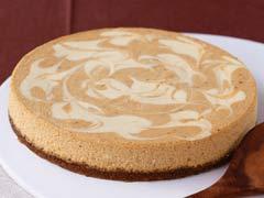 Pumpkin Swirl Cheesecake - A Pumpkin Swirl Cheescecake with a ginger biscuit and pecan base. Yumm!