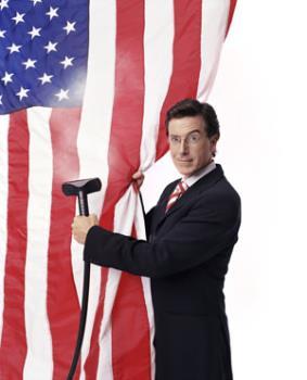 Stephen Colbert - Stephen steam cleans the flag.