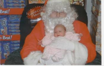 baby and santa - this is my daughter 2 months after she was born