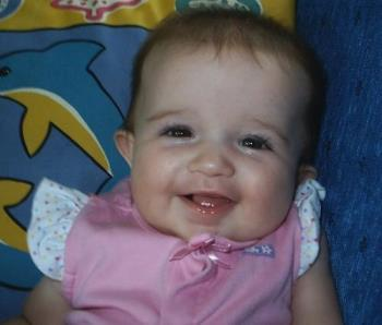 My granddaughter - This is my 6 month old granddaughter Mackenzie Grace. She is a little treasure, always pleasant, always smiling.