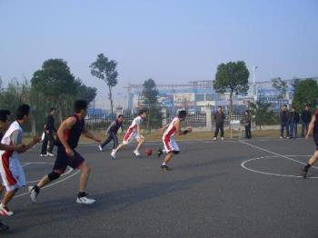basketball playing on the court  - This picture shows that our team and another team is playing basketball. Ours wear white sportswear.