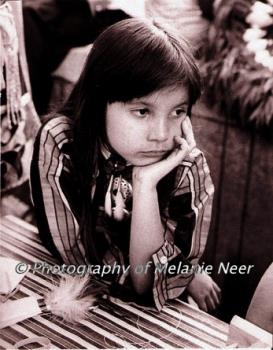 Sepia toned black and white print - image of a osage girl at powwow