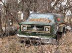 juck truck - a junk truck in a field