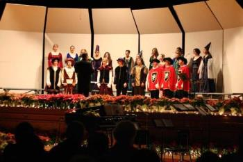 Christmas Concert - This photo was taken with my Canon Rebel Xt using a 50mm f1.8 lens and the ISO set at 1600. No flash was used.
