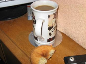 Snacking At The Puter - coffee and donut for a snack