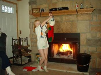 My daughter taking her stocking down to empty.  - I love my fireplace.