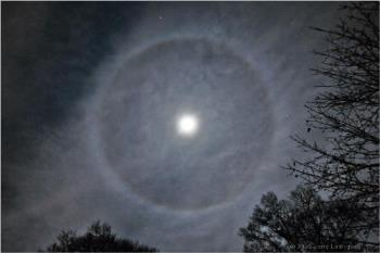 Halo around trhe moon - Lunar halos are caused by moonlight being refracted by cirro-stratus clouds.