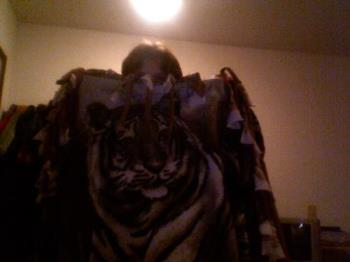 this is me and my favorite blanket - I sleep with 3 different blankets but this one is the softest blanket. I love tigers. I love making these no sew blankets.