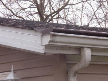 Gutter caps - Best I could do with a pic of it. Prevents debris flowing into the gutters and ice forming near the roof edge/on the gutters.