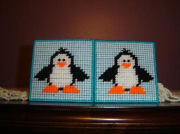 Penguin coasters - Penguin coasters made with yarn and plastic canvas
