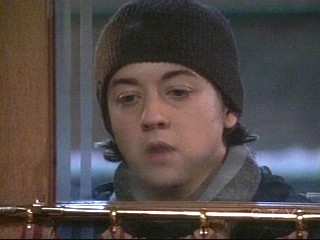 spinelli - snapshot of spinelli peeking in the window at Kelly's on GH and daydreaming