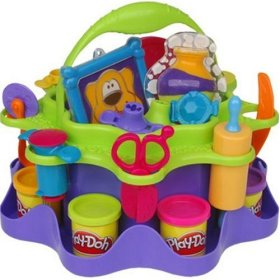 Playdoh craft caddy with playdoh and tools - Designed to allow several kids to work together the art caddy comes with play mat, PLAY-DOH PICK UP STICK tool, 2 stained glass frames, 2 sand art bottles, necklace, bracelet, 3 bead-making molds, frosting presser with 3 tips, cake-decorating plate, scissors, dust pan, rolling pin, pizza cutter, knife
