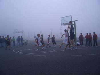a basketball match on a foggy winter morning - our school team is having a basketball match with another team from a different school.