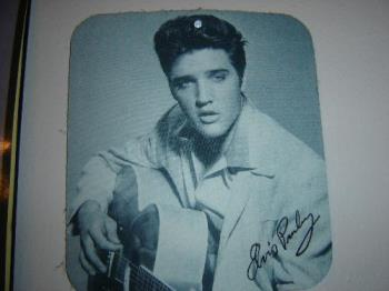 Elvis Presley - Mousepad that is on a wall in the computer room.