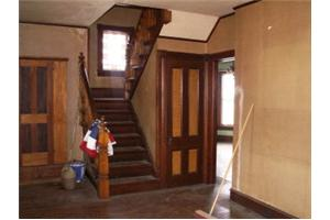 the entryway/foyer - I love this photo. It shows off the original woodwork. Obviously those are the stairs lol and notice the stained glass in the window on the landing, so pretty. Through the door way is the dining room to the left (visible) and the two living rooms to the right (not pictured)