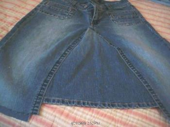 jean pant turned into a skirt - cut the legs off. sew the leg to the center of the skirt. stitch the edges and your done