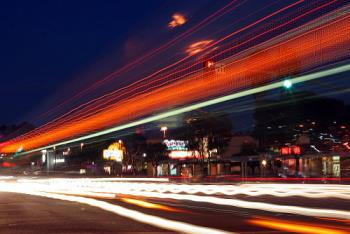 Here is an example of what I can do with my camera - I took this photo at night with a long exposure. It captured the streaking headlights of the buses and cars in the area.
